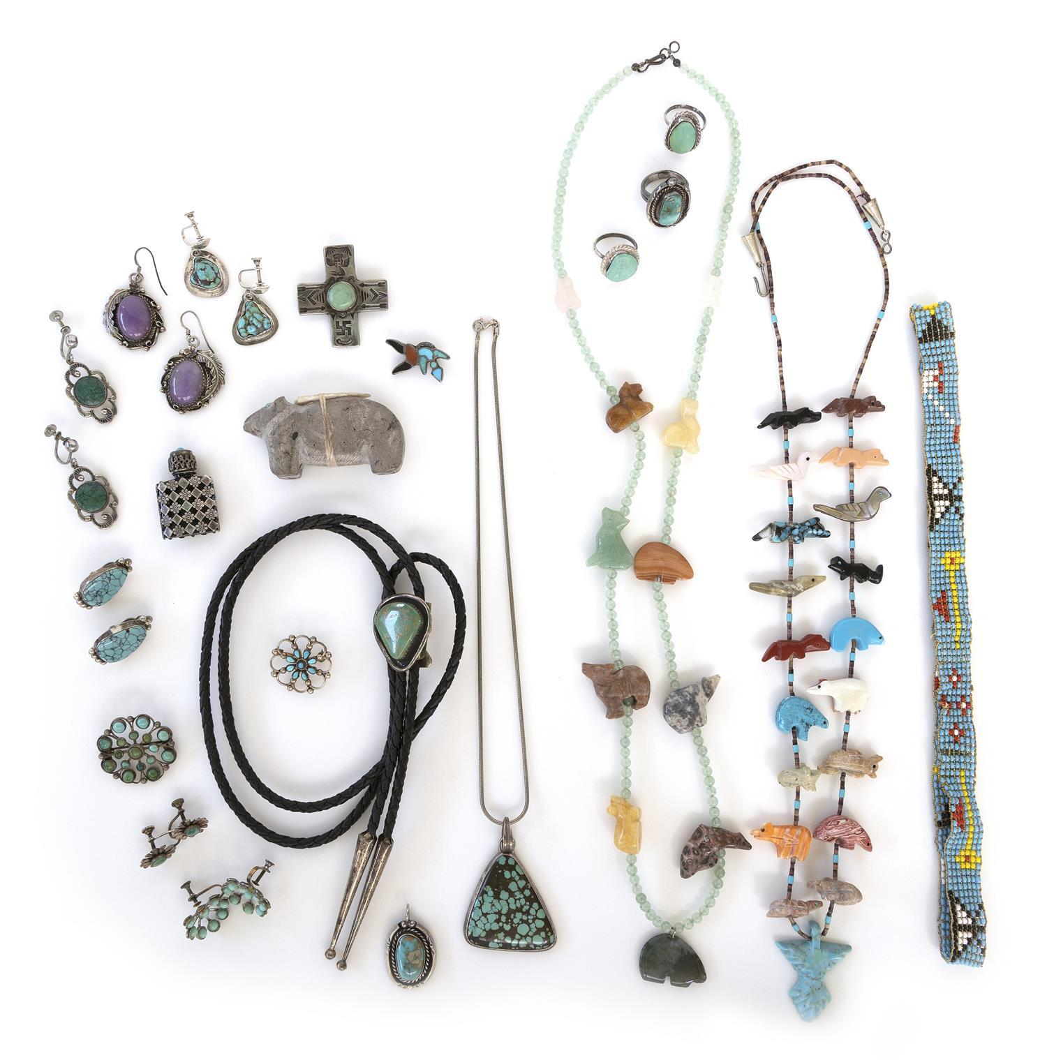 NINETEEN PIECES OF SOUTHWEST AND AMERICAN INDIAN JEWELRY Together with a French silver, glass and turquoise perfume bottle and a Zun...