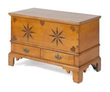 ELDRED WHEELER NANTUCKET BLANKET CHEST In maple. Lid attached with iron hinges. Front with inlaid hearts and compass roses. Two side...