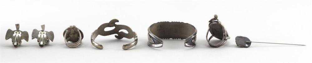 FIVE PIECES OF SILVER JEWELRY Together with a silver-tone S-form cuff bracelet. Sterling silver unless otherwise noted. 1) Georg Jen...