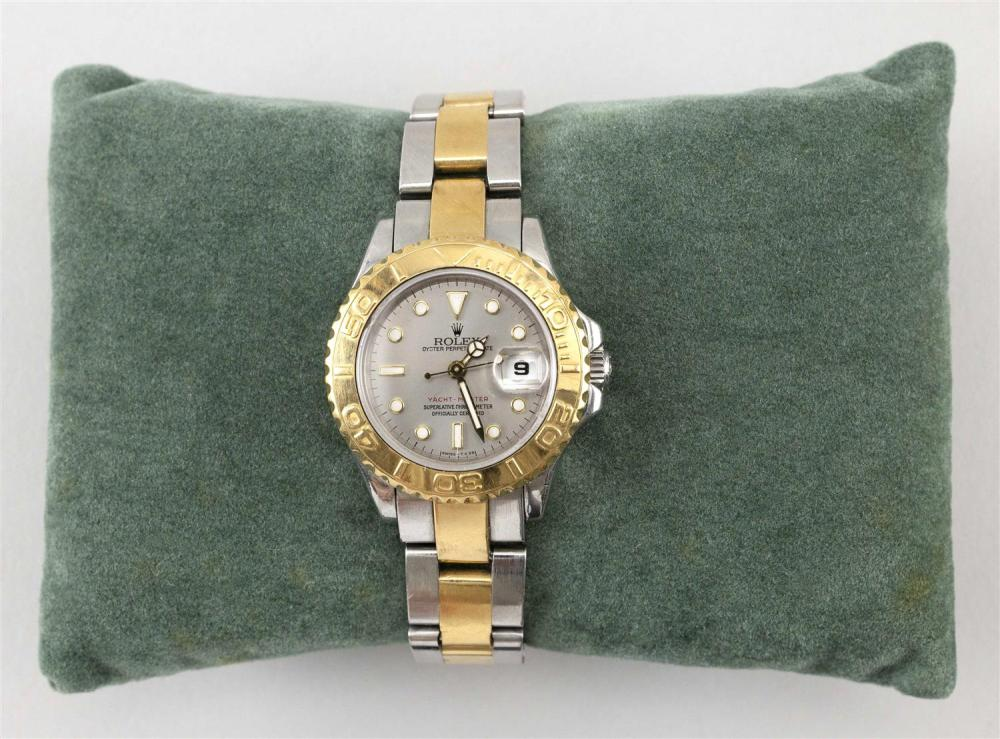 ROLEX YACHT MASTER OYSTER PERPETUAL DATE 18KT GOLD AND STAINLESS STEEL LADY'S WRIST WATCH Serial number U439276. Ref. 69623. Gray di..