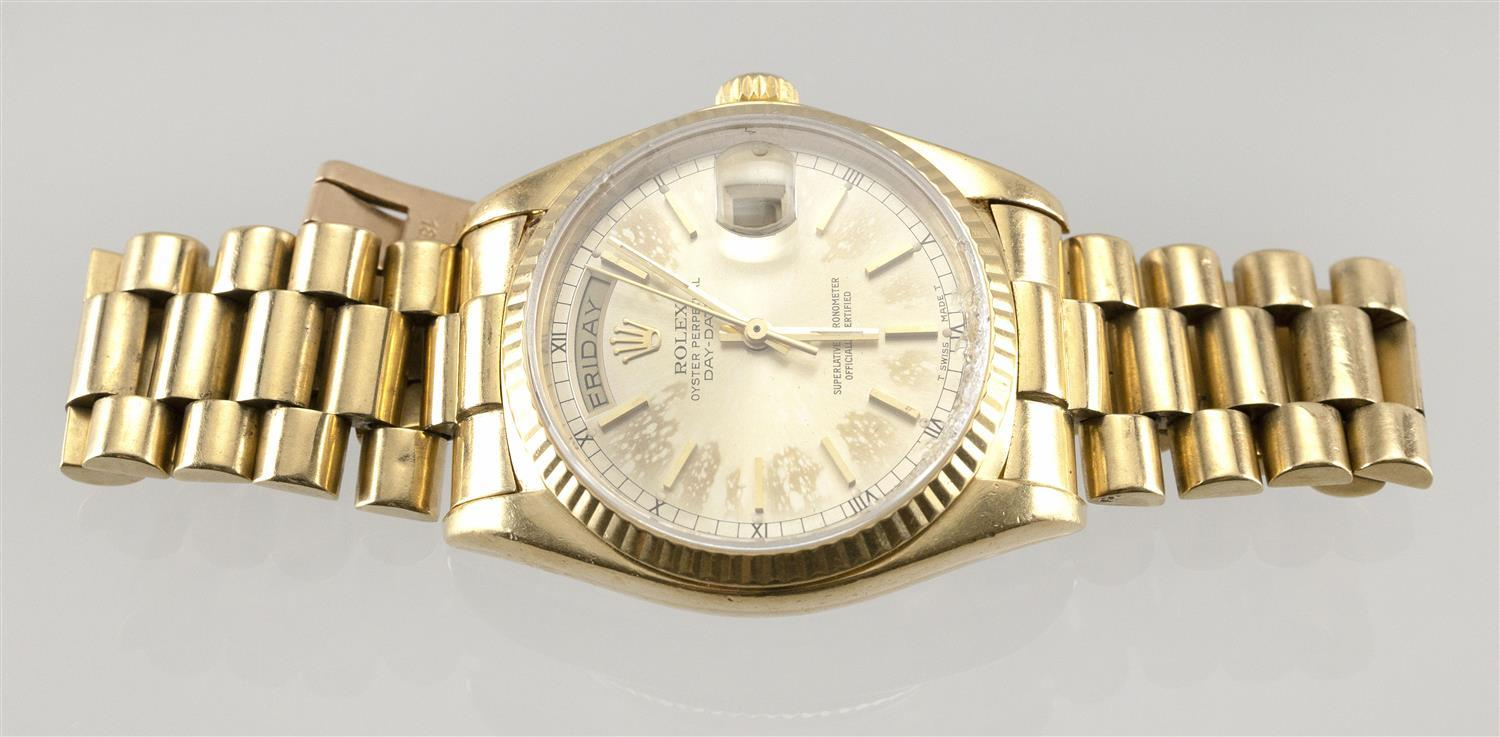 ROLEX OYSTER PERPETUAL DAY-DATE 18KT GOLD MAN'S WRIST WATCH Champagne dial with raised gold baton hour markers. Outer minute and hal..