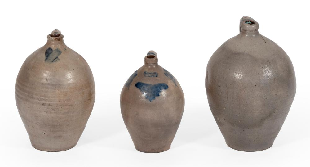 """THREE OVOID STONEWARE JUGS 19th Century Heights from 12"""" to 16""""."""