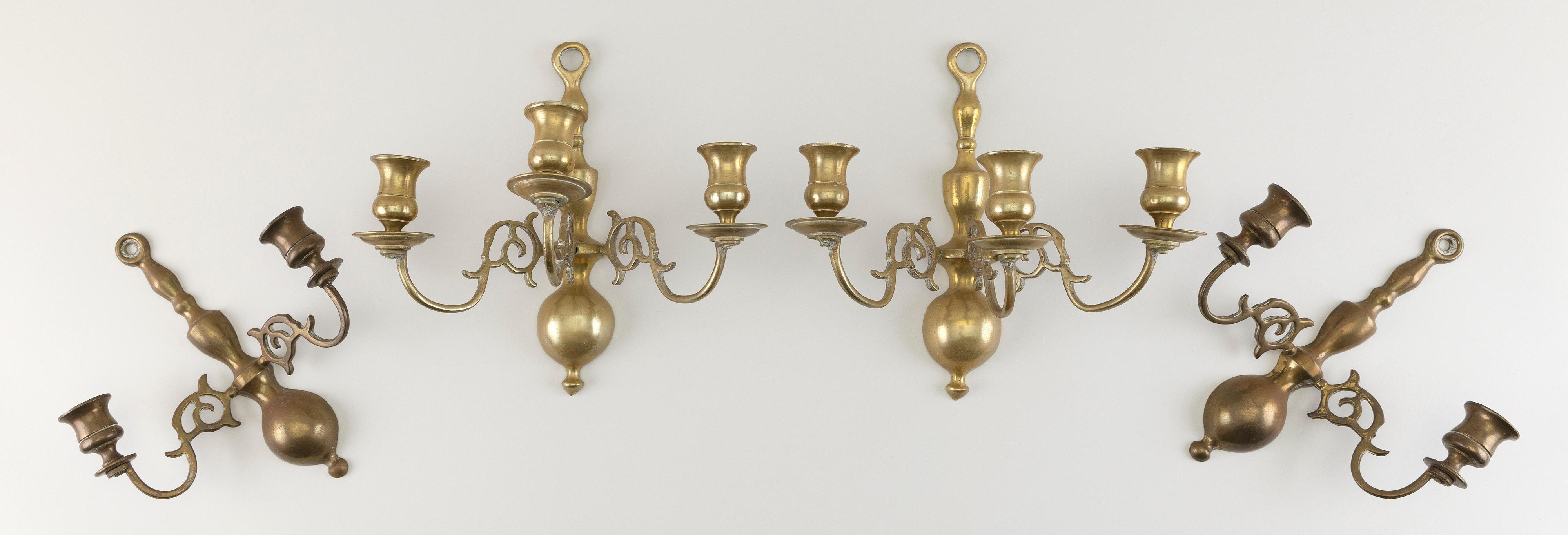 "TWO PAIRS OF BRASS WALL SCONCES Early 20th Century Heights 9"" and 10""."