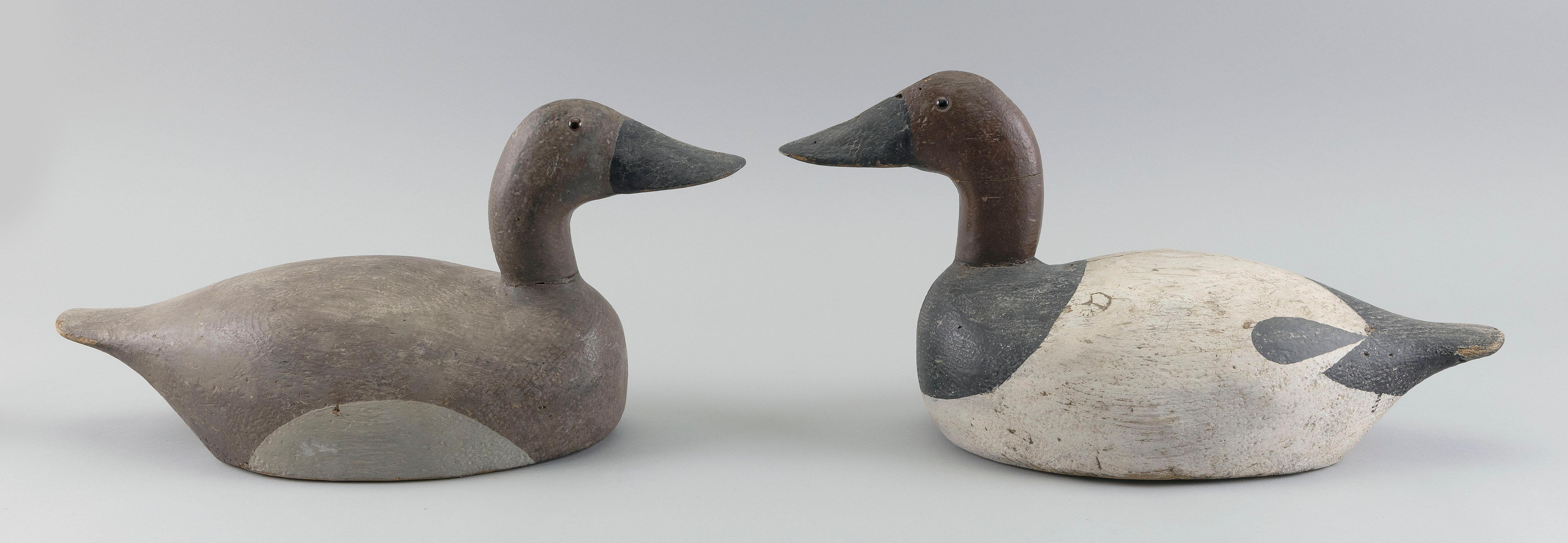 """PAIR OF ALBERT KOEPSEL CANVASBACK DECOYS Neenah, Wisconsin, 20th Century Lengths 17"""" and 18""""."""