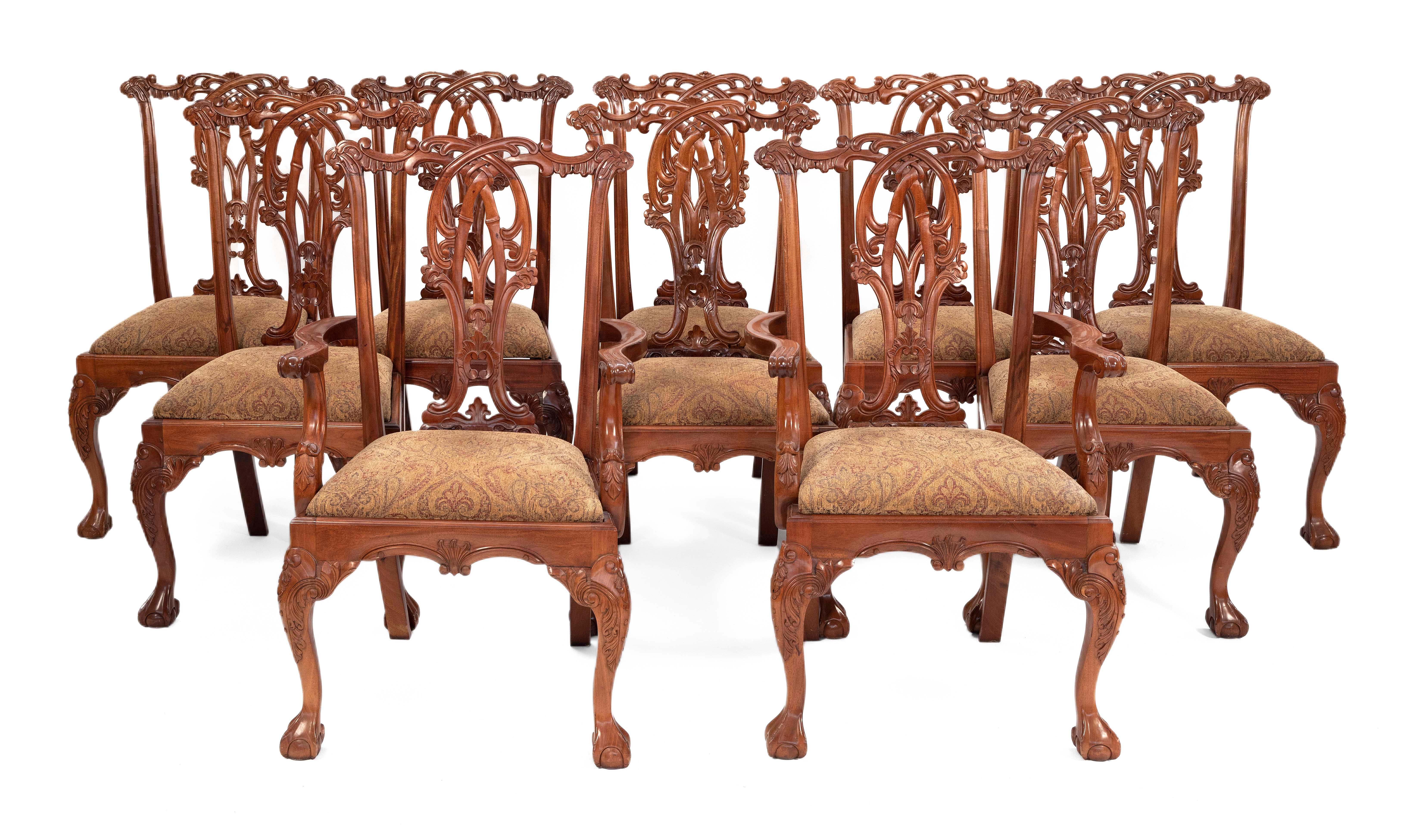 """SET OF TEN CHIPPENDALE-STYLE DINING CHAIRS Back heights 40"""". Seat heights 19.5""""."""