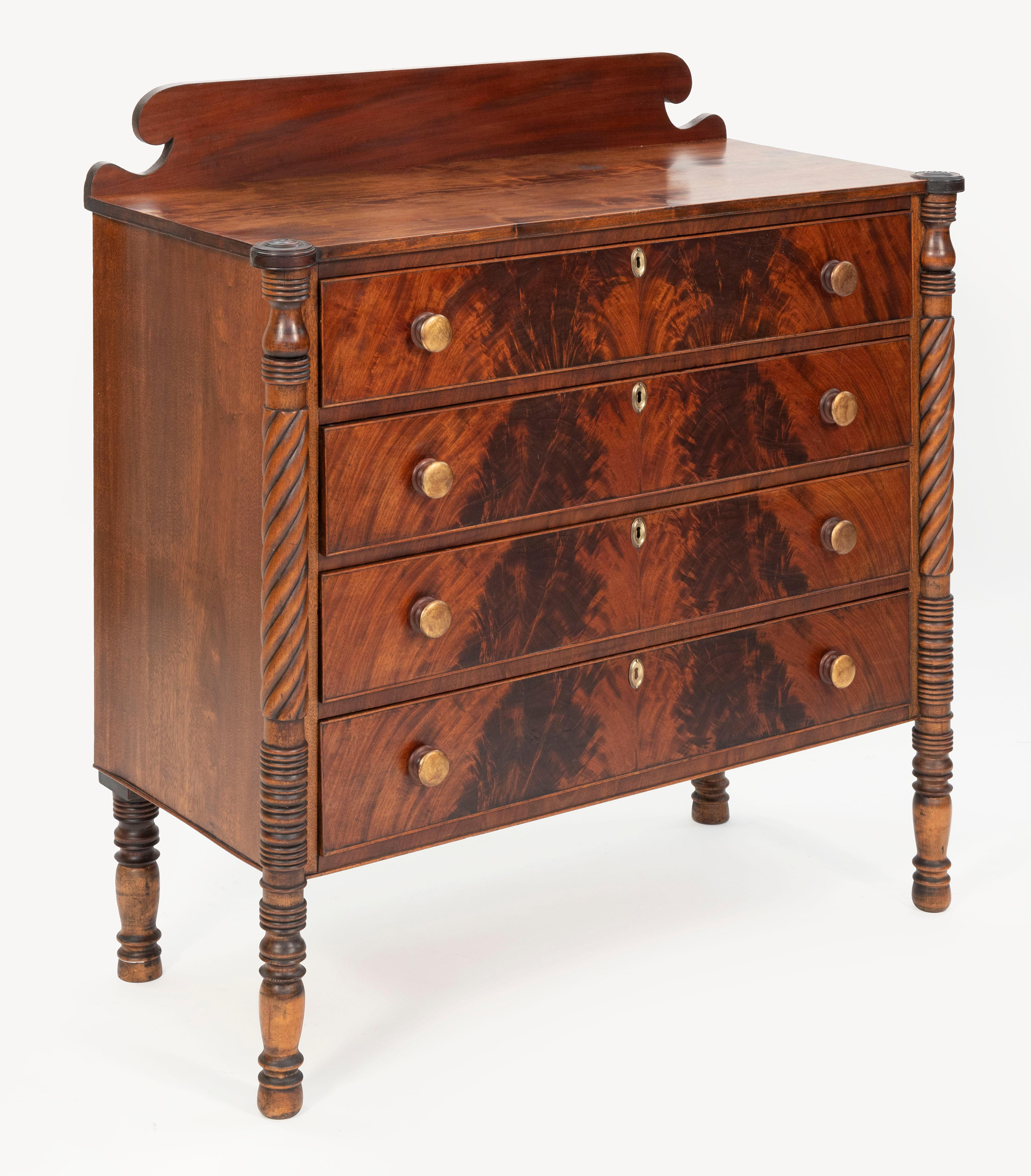"SHERATON COOKIE-CORNER FOUR-DRAWER CHEST Circa 1840 Height 44.5"". Width 43.75"". Depth 20""."