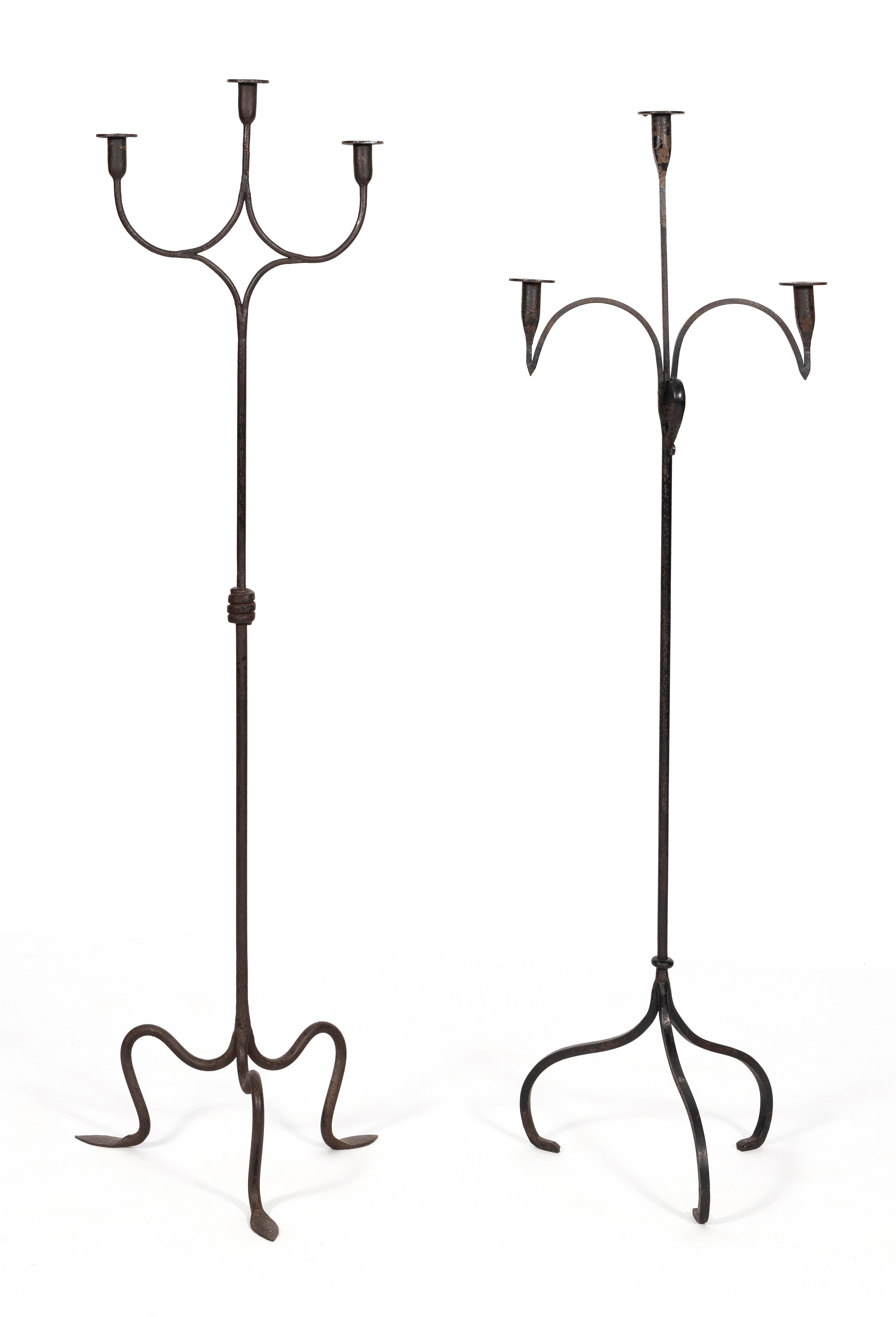 """TWO WROUGHT IRON FLOOR CANDLEHOLDERS 20th Century Heights 58"""" and 59.5"""". Widths approx. 16.5""""."""