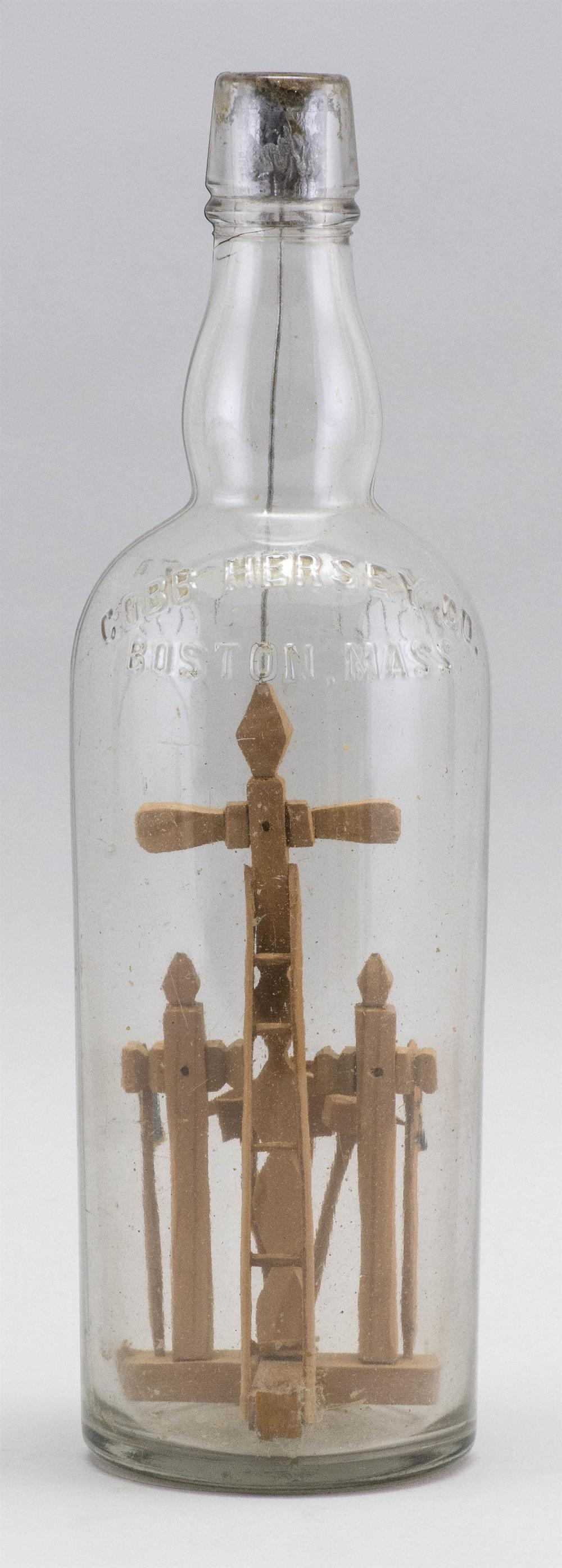 PUZZLE BOTTLE CONTAINING A CRUCIFIX AND TOOL ITEMS Height 12.5