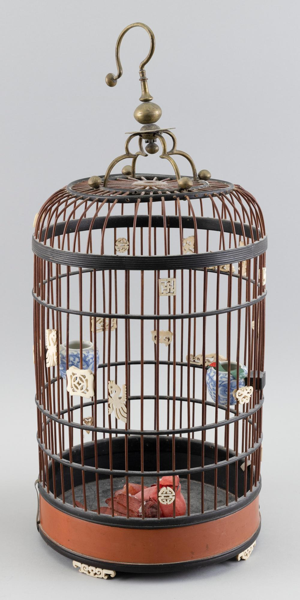 """CHINESE LAQUERED WOOD BIRDCAGE Early 20th Century Height 20.5"""". Diameter 9""""."""