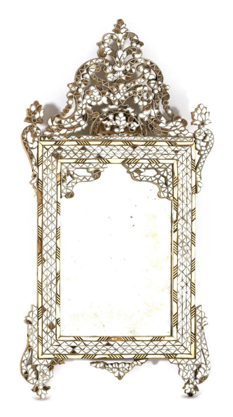 SYRIAN MIRROR WITH MOTHER-OF-PEARL INLAY With pierced foliate crest and carved bone accents. Height 34