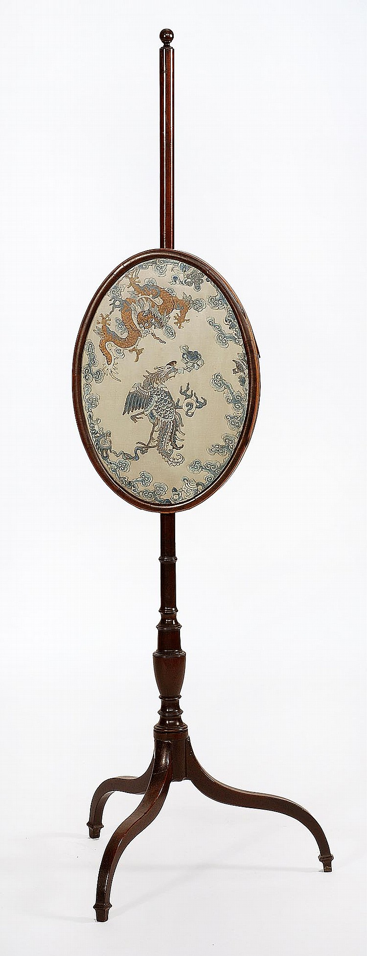 POLE SCREEN In mahogany with Chinese needlework panel depicting a dragon and phoenix in an oval cartouche. Overall height 52