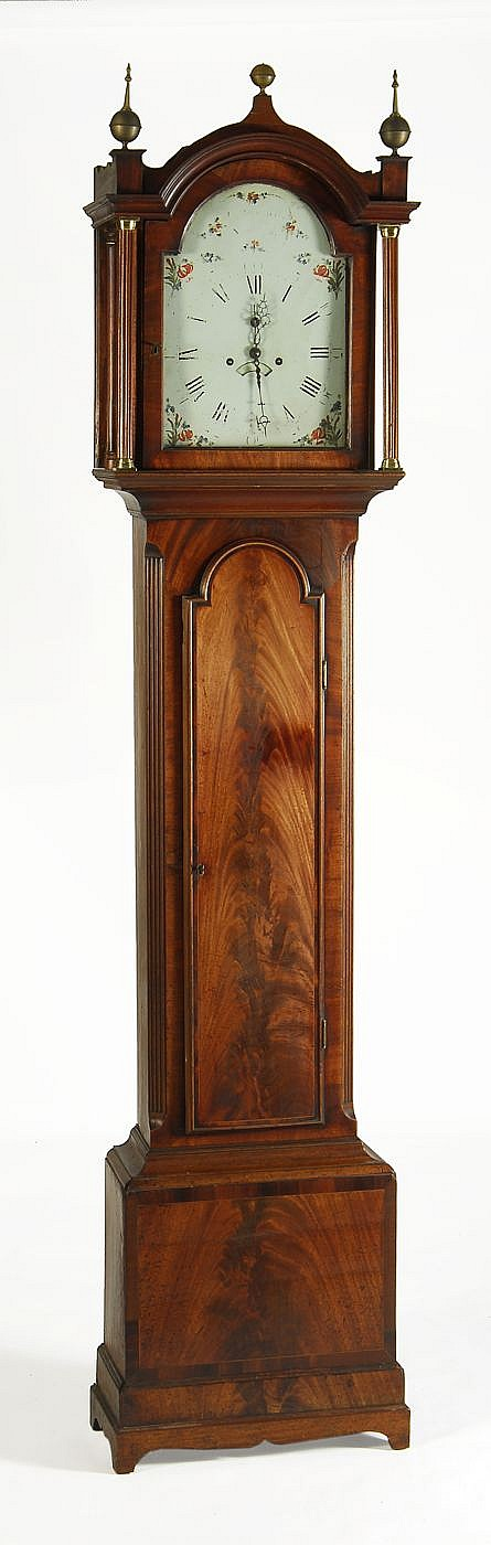 ANTIQUE ENGLISH TALL-CASE CLOCK In walnut with mahogany case. Bonnet top fronted by full columns. Dial marked