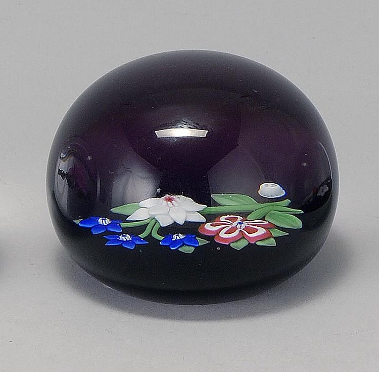 CONTEMPORARY BACCARAT GLASS PAPERWEIGHT In a multicolor floral design on an amethyst ground. Signed in interior and on bottom. Dated...