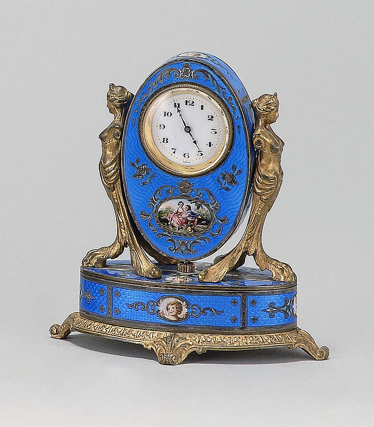 AUSTRIAN ENAMEL BOUDOIR CLOCK In snuff box form with figural decoration on a blue guilloché ground. Height 4¼