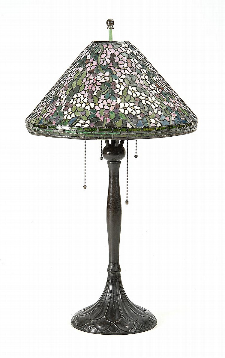 HANDEL LEADED GLASS TABLE LAMP Shade in an apple blossom pattern, and base in a leaf pattern. Marked on base and shade. Height 33