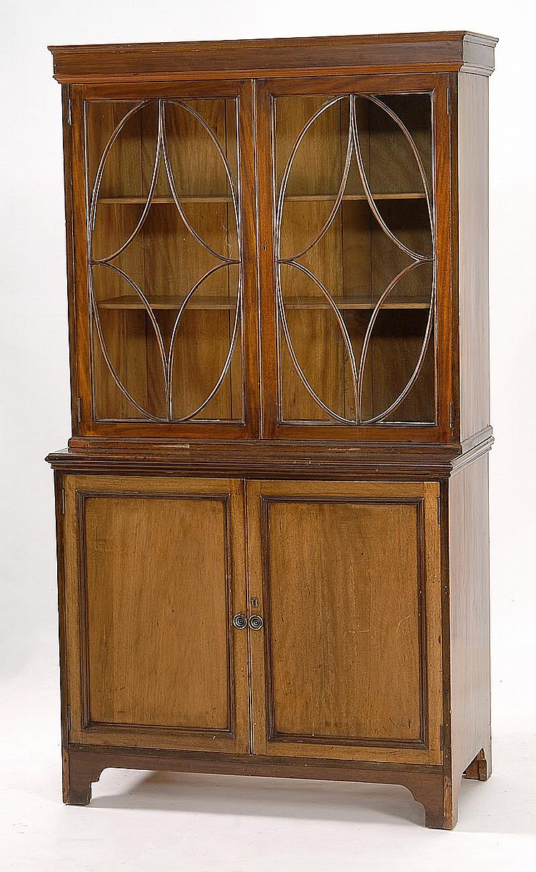 ANTIQUE ENGLISH TWO-PART CHINA CABINET In mahogany. Upper cabinet with glazed doors and shelved interior. Lower cabinet with paneled...