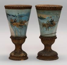 PAIR OF RUSSIAN CARVED AND PAINTED WOODEN GOBLETS Conical bowls with polychrome hand-painted scenes of troikas in the snow. Stems an...