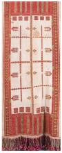 CONTINENTAL EMBROIDERED TABLECLOTH Dense geometric stitching in red and green against flax-colored linen. Polychrome fringe. 72