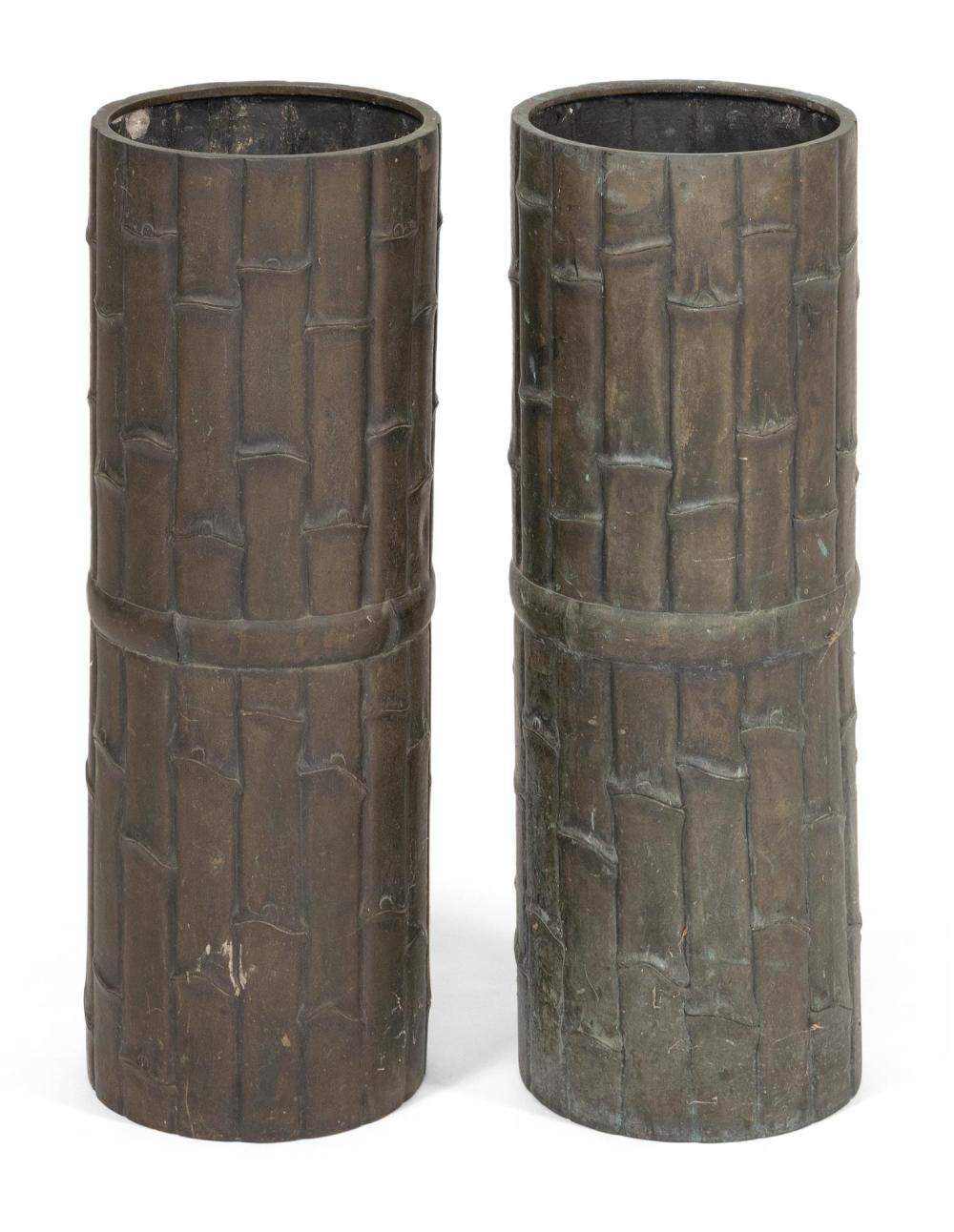 """PAIR OF BRONZE UMBRELLA STANDS IN THE FORM OF BAMBOO BUNDLES Together with a similar footed jardinière, height 10.5"""". Stands with so..."""