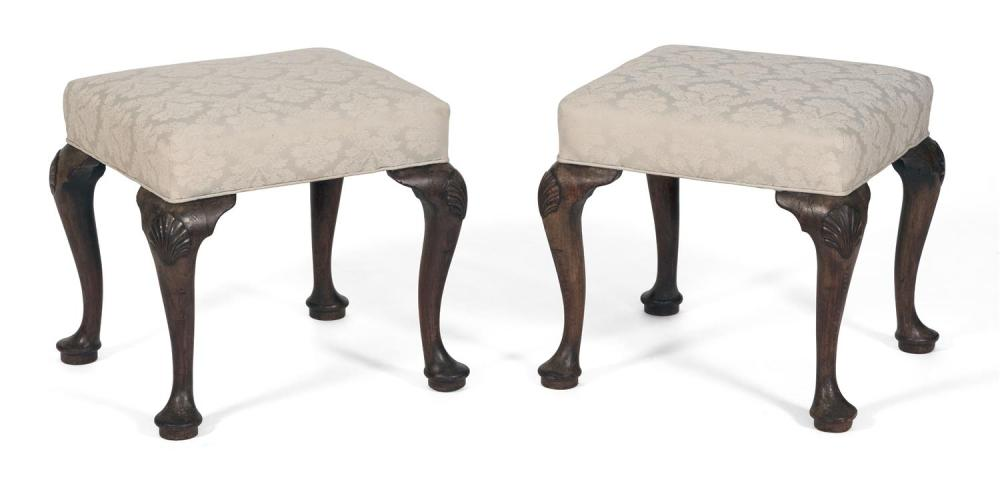 PAIR OF GEORGE II FOOTSTOOLS In walnut, with soft green printed upholstered seats. Cabriole legs with shell-carved knees and pad fee...