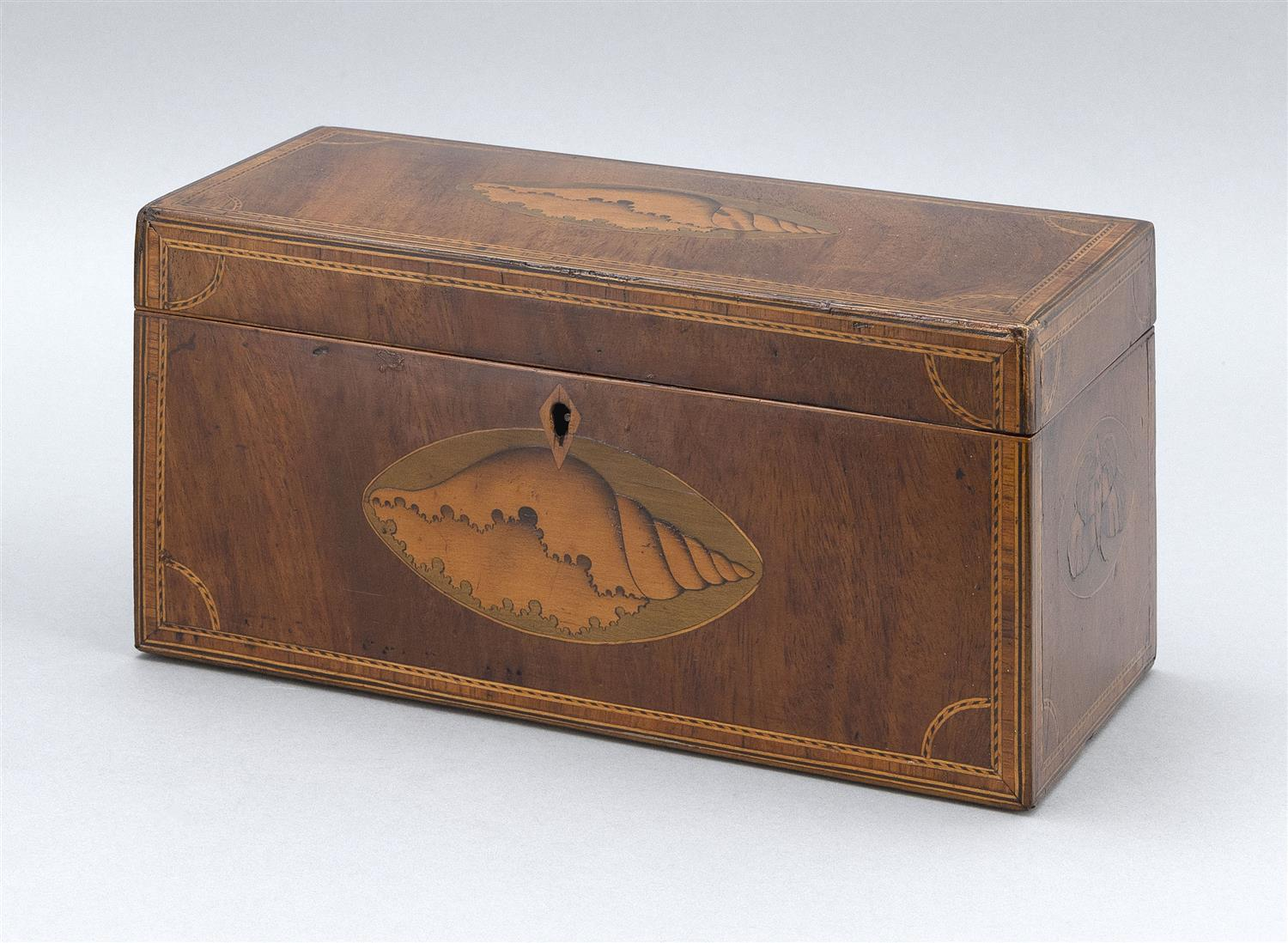 """ENGLISH TEA CADDY Mahogany veneer with fruitwood shell and butterfly inlay. Compartmented interior. Height 5.25"""". Width 10"""". Depth 5""""."""