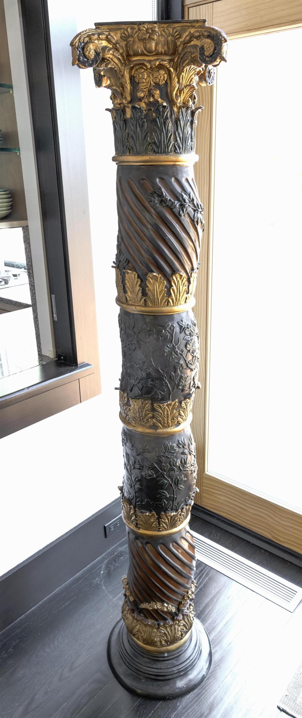 CAST BRONZE RENAISSANCE-STYLE COLUMN Spiral and foliate-design shaft with four bands of gilt acanthus leaves. Stepped rounded base....