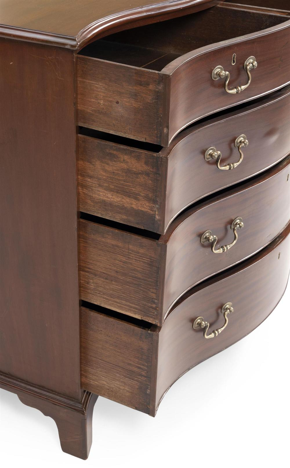 ENGLISH SERPENTINE-FRONT BUREAU In mahogany. Two half drawers over three graduated full-width drawers, all with cock-bead molding an...