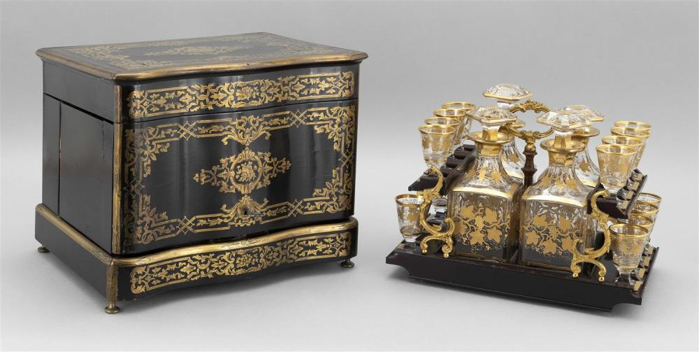 CONTINENTAL BLACK LACQUER TANTALUS Lid and front of case with inlaid foliate brass details. Top lifts and hinged sides open to revea...