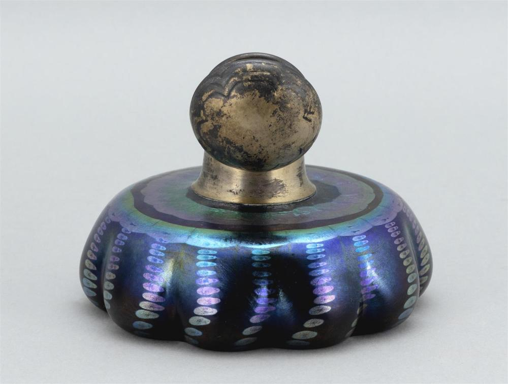 TIFFANY STUDIOS BLUE FAVRILE GLASS INKWELL Domed gilt brass cover with incised petal design. Squat, lobed body with flat shoulder an...