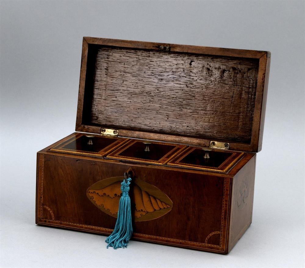 ENGLISH TEA CADDY Mahogany veneer with fruitwood shell and butterfly inlay. Compartmented interior. Height 5.25