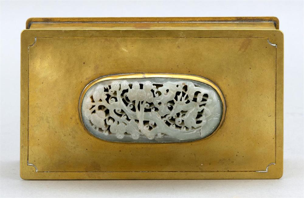 POTTER STUDIO ARTS & CRAFTS BRASS AND JADE HUMIDOR Early 20th Century celadon green jade plaque openwork-carved with a stag beneath...