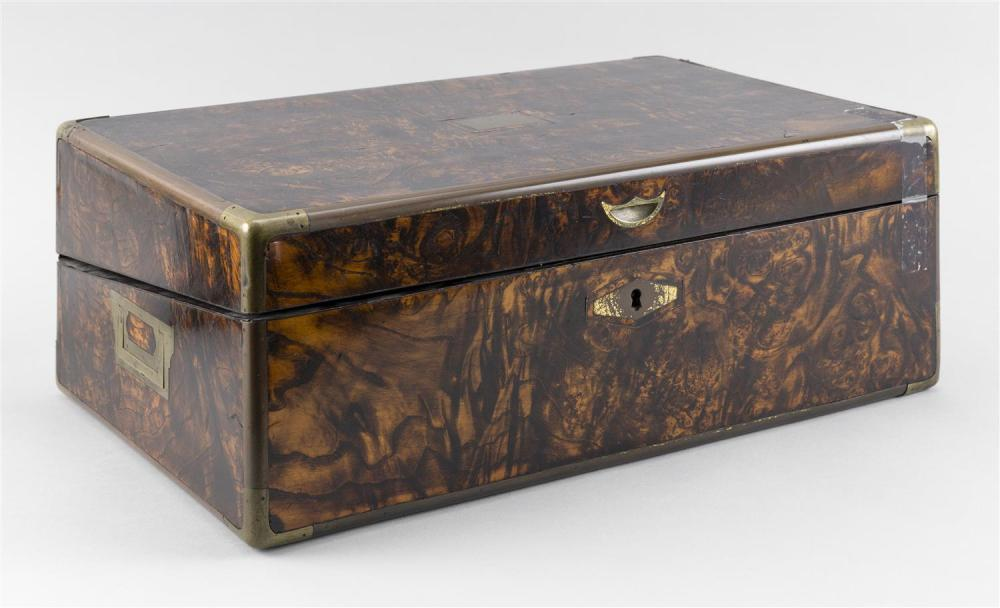 BRASS-BOUND LAP DESK In a highly figured hardwood veneer. Recessed carrying handles at sides of case. Top lifts open to reveal a gre...