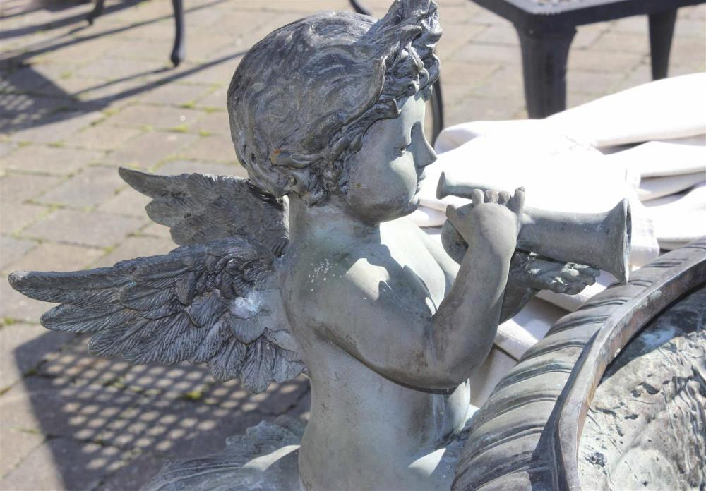 BRONZE GARDEN FOUNTAIN In the form of three putti around the edge of an urn, on a tripod base. Height 40