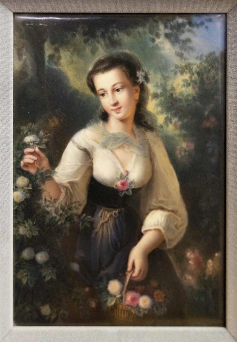 KPM PORCELAIN PLAQUE Depicts a young woman picking roses in a garden. Signed illegibly lower right. Inscribed verso