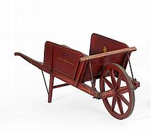 WOODEN WHEELBARROW Retains paper label for the
