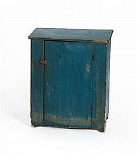 ANTIQUE AMERICAN MINIATURE CUPBOARD In pine painted a strong blue. Latched door opens to reveal two interior shelves. Shaped base. H...