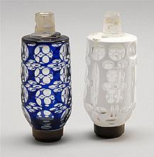 TWO CUT OVERLAY GLASS PEG LAMPS One in cobalt cut to clear and one in opaque white cut to clear. Heights 5