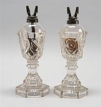 PAIR OF SANDWICH CLEAR GLASS WHALE OIL LAMPS In Sweetheart pattern. Retain original pewter collars and double burners. Height 9.5