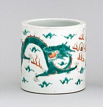 POLYCHROME PORCELAIN BRUSH POT With three four-claw dragons and rust-red pearl design. Orange enamel mark on base. Height 5.2