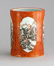 FAUX BOIS AND GRISAILLE PORCELAIN BRUSH POT In cylinder form with landscape cartouches. Six-character Qianlong mark on base. Height...
