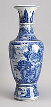 BLUE AND WHITE PORCELAIN VASE In baluster form with figural landscape cartouches on a blue flower and lattice ground. Four-character...