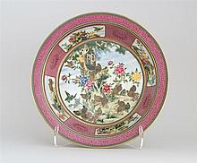 PORCELAIN BOWL With everted rim. Superbly painted quail and flower design on a burgundy-red floral ground. Six-character Qianlong ma...