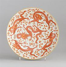 CORAL-RED DECORATED PORCELAIN CHARGER With five-claw dragon design. Six-character Guangxu mark on base. Diameter 15.7