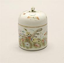 POLYCHROME PORCELAIN BOX In cylinder form with butterfly and flower design. Peach-form finial. Height 3.75