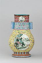 POLYCHROME PORCELAIN VASE In pear shape with cylindrical handles. Body decorated with landscape cartouches of winter scenes and spri...