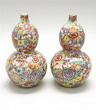 PAIR OF PORCELAIN VASES In double gourd form with Thousand Flowers pattern. Six-character Qianlong mark on base. Height 6.75