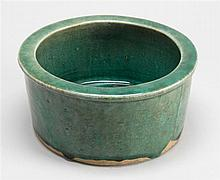 GREEN GLAZE POTTERY COVERED BOWL/CRICKET CAGE In cylinder form with four-character mark on base. Wood cover. Diameter 7.8