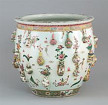 FAMILLE ROSE PORCELAIN JARDINIÈRE In ovoid form with unusual relief vase design. Diameter 15.5