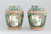 PAIR OF FAMILLE VERTE PORCELAIN JARS In ovoid form with floral cartouches on a floral ground. Height 12.5