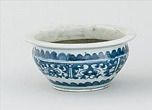 BLUE AND WHITE PORCELAIN JARDINIÈRE In ovoid form with stylized dragon design. Diameter 5.8